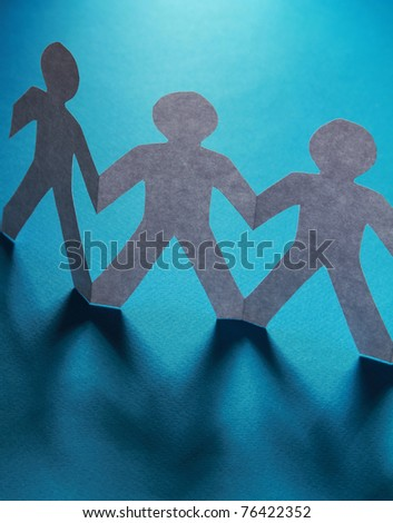 Paper people with their hands together - stock photo