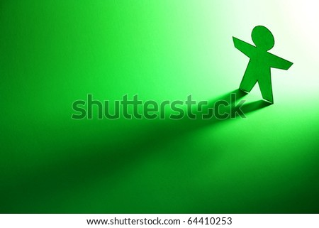 paper person coming out of the light - stock photo