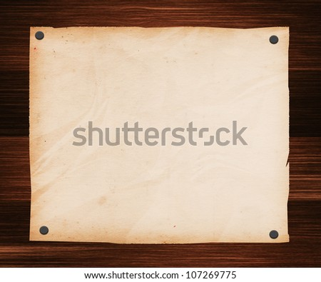 Paper Pinned to a Wooden Plank - stock photo