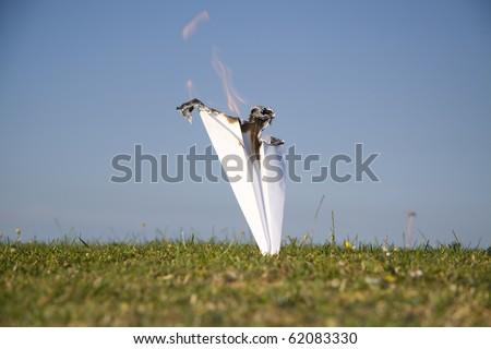 Paper plane crash - stock photo