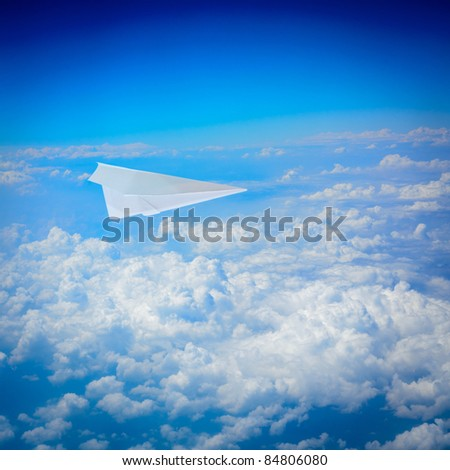 paper plane flying in sky background