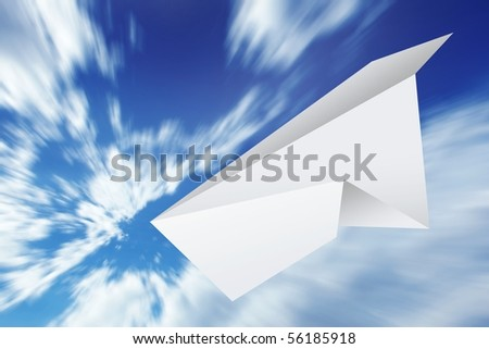 Paper plane flying on blue sky with clouds - stock photo