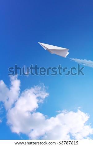 Paper plane in blue sky - stock photo