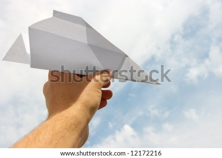 Paper plane in human hand - stock photo