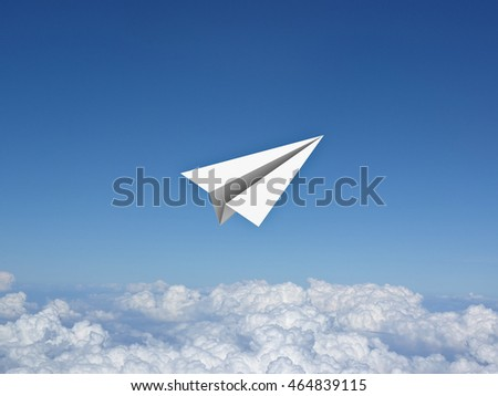 Paper plane in the blue sky above clouds . 3D rendering.