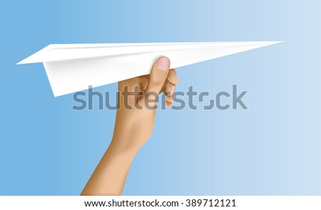 Paper plane in the hand ready for launch