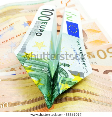 paper plane made with a 100 euro bill - stock photo