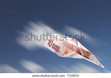 Paper plane made with a ten euro banknote falling. - stock photo