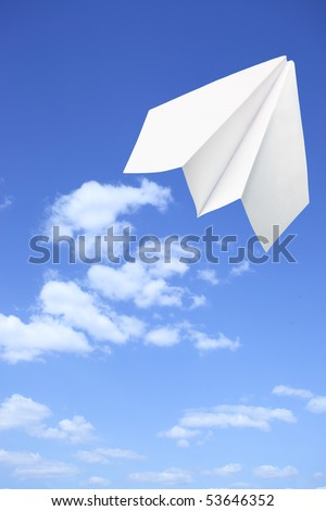 Paper plane taking off. Sky and clouds in the background - stock photo