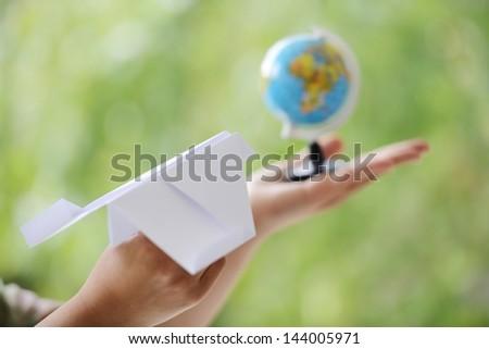 Paper plane traveling to globe world - stock photo