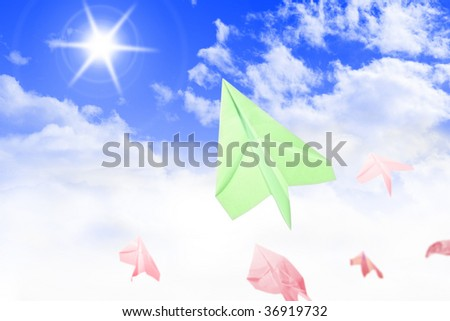 paper planes flying in the sky - stock photo