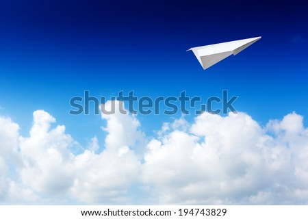 Paper planes in blue sky. Sky background