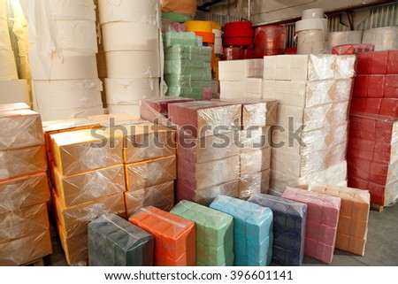 Paper products and goods storehouse with boxes - stock photo