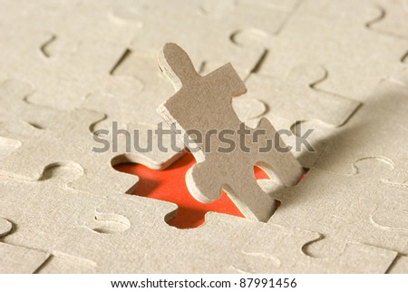 Paper puzzles on a red background. One puzzle is open. - stock photo