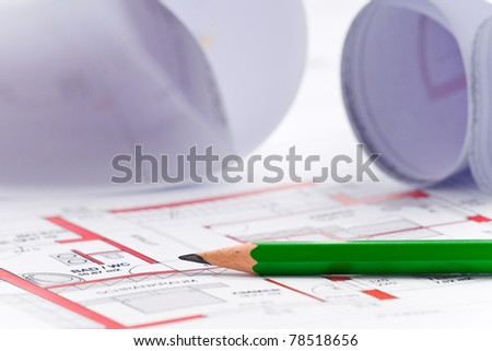 paper roll of a construction plan for a house - stock photo