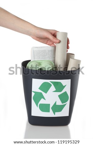Paper rubbish putting into recycle bin, isolated - stock photo