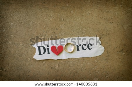 Paper scrap with Divorce text, wedding ring and red broken heart - stock photo