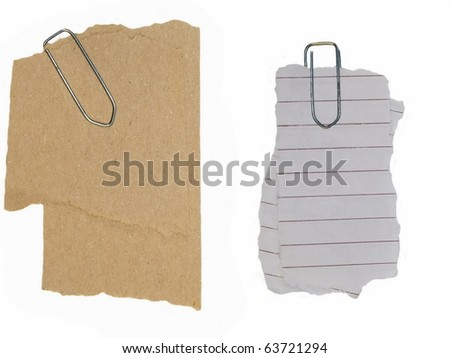 paper scraps and paperclip isolated on white background - stock photo