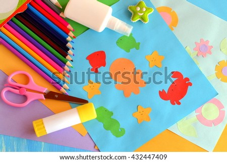 Paper sea animals and flowers crafts. A set of materials and tools for kids art. Easy way to realize kids imagination. Development of creative abilities in preschool children, primary school children. - stock photo