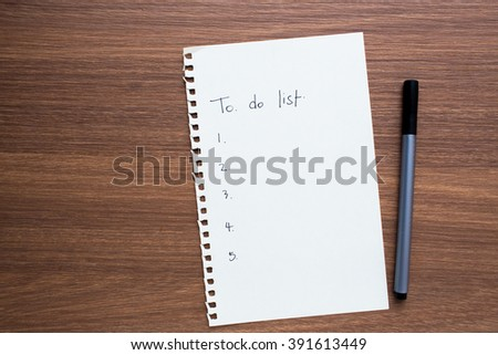 Paper Sheet with Empty to do list and Pen on Wooden Background