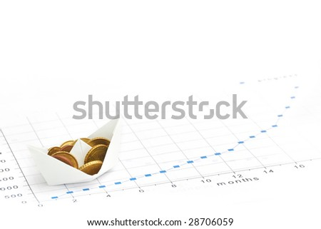 Paper ship carrying money along the finance diagram - stock photo