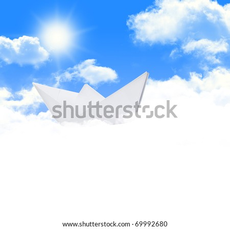 Paper ship cruising on beautiful sky with clouds