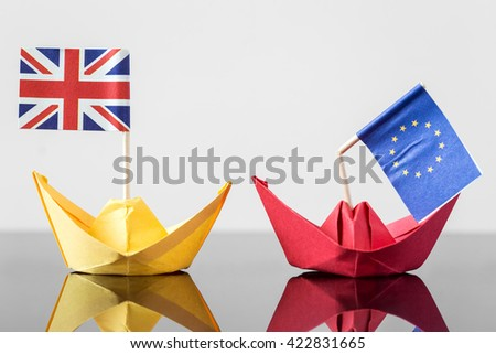 paper ship with british and european flag, concept shipment or free trade agreement and membership of eu, brexit - stock photo