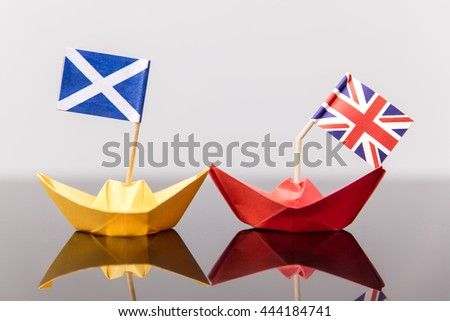 paper ship with british and scots flag, concept shipment or free trade agreement and membership of eu, independence referendum