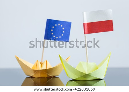 paper ship with polish and european flag, concept shipment or free trade agreement and membership of eu
