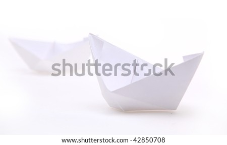 paper ships isolated on white - stock photo