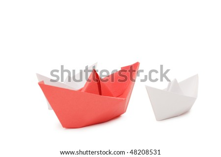 Paper ships isolated on white background - stock photo