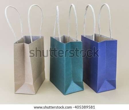 Paper shopping bag isolated on brown background - stock photo