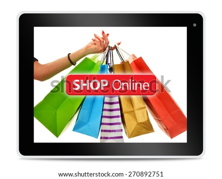 Paper shopping bags on computer tablet screen. Shopping online. E-commerce - stock photo