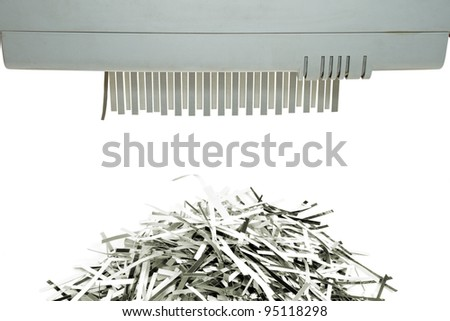 Paper shredder and shred mount isolated on white background - stock photo