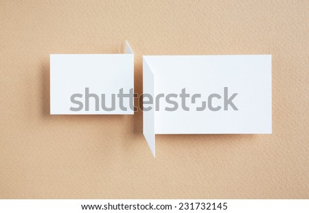 paper speech bubble on brown background - stock photo