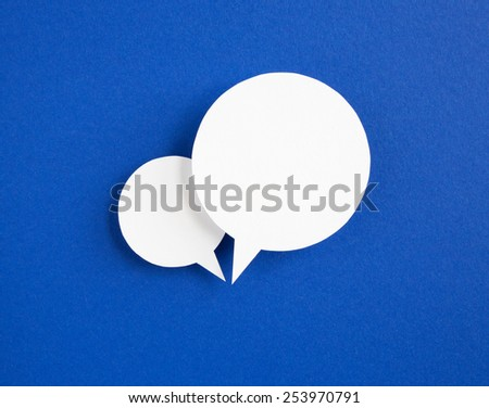 paper speech bubbles on blue background - stock photo