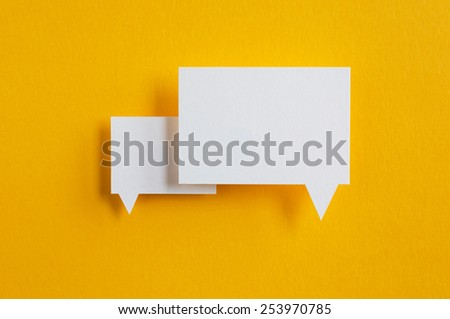 paper speech bubbles on yellow background - stock photo