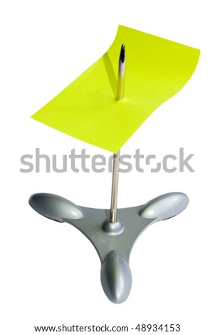 Paper spike with a yellow piece of paper on it (isolated on white)