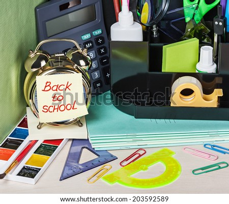 paper sticker on the alarm clock back to school