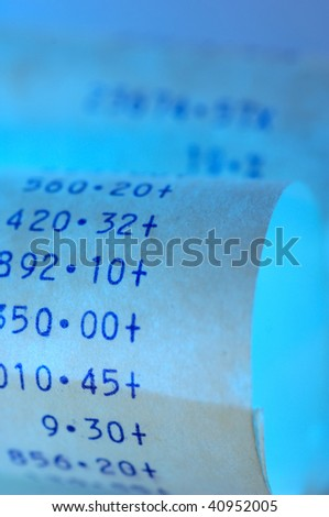 Paper strip of an calculating machine - stock photo