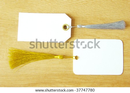 paper tag isolated on a wooden background