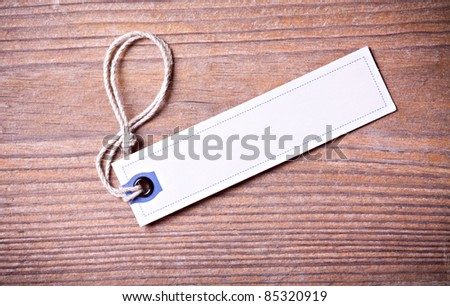 Paper tag over wooden background - stock photo