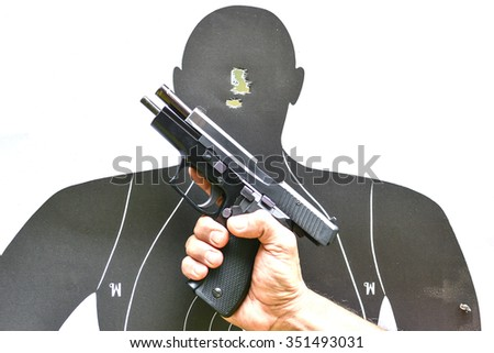 Paper target and pistol   - stock photo