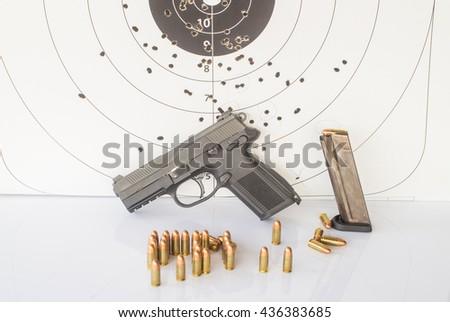 paper target gun pistol magazine - stock photo