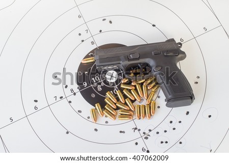 paper target gun pistol magazine and bullet. - stock photo