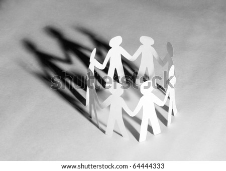 paper team linked together - stock photo