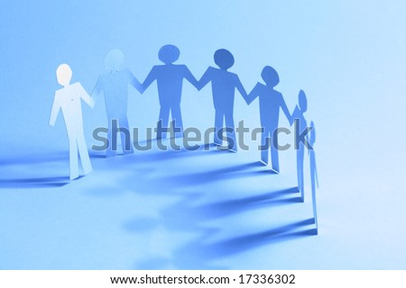 paper team linked together partnership concept - stock photo