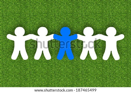 Paper team white people over grass background  - stock photo