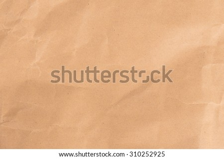 Paper texture - brown crumpled paper sheet - stock photo