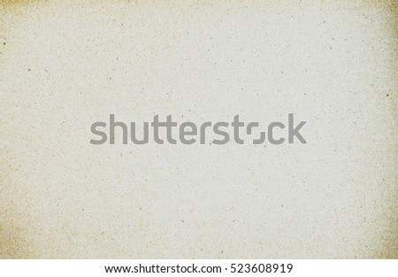 Paper texture color light rough textured spotted blank copy space background in beige, yellow, brown